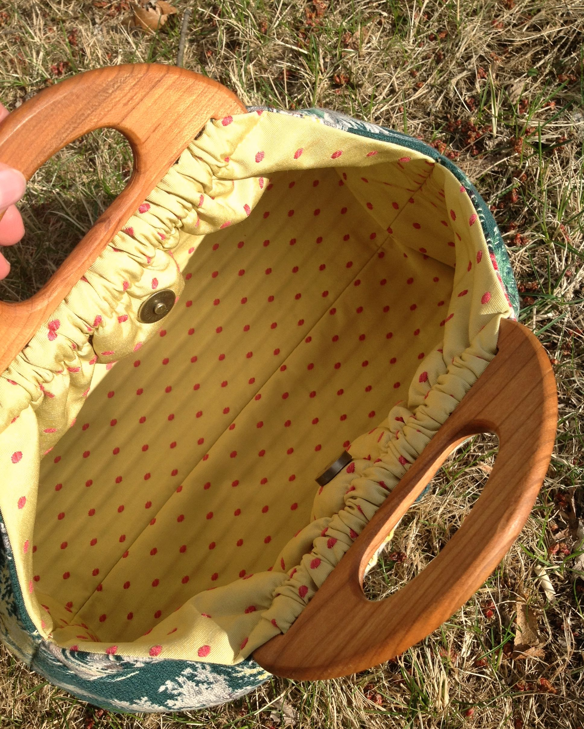 Little bag, but a roomy base.... Vermont mini Cherry handles.