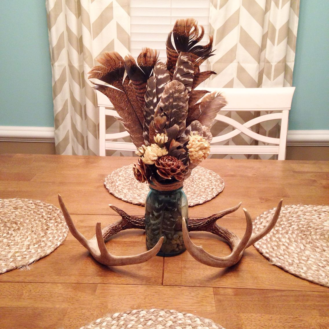 Rustic dining room table centerpiece turkey feathers for Rustic dining table centerpieces