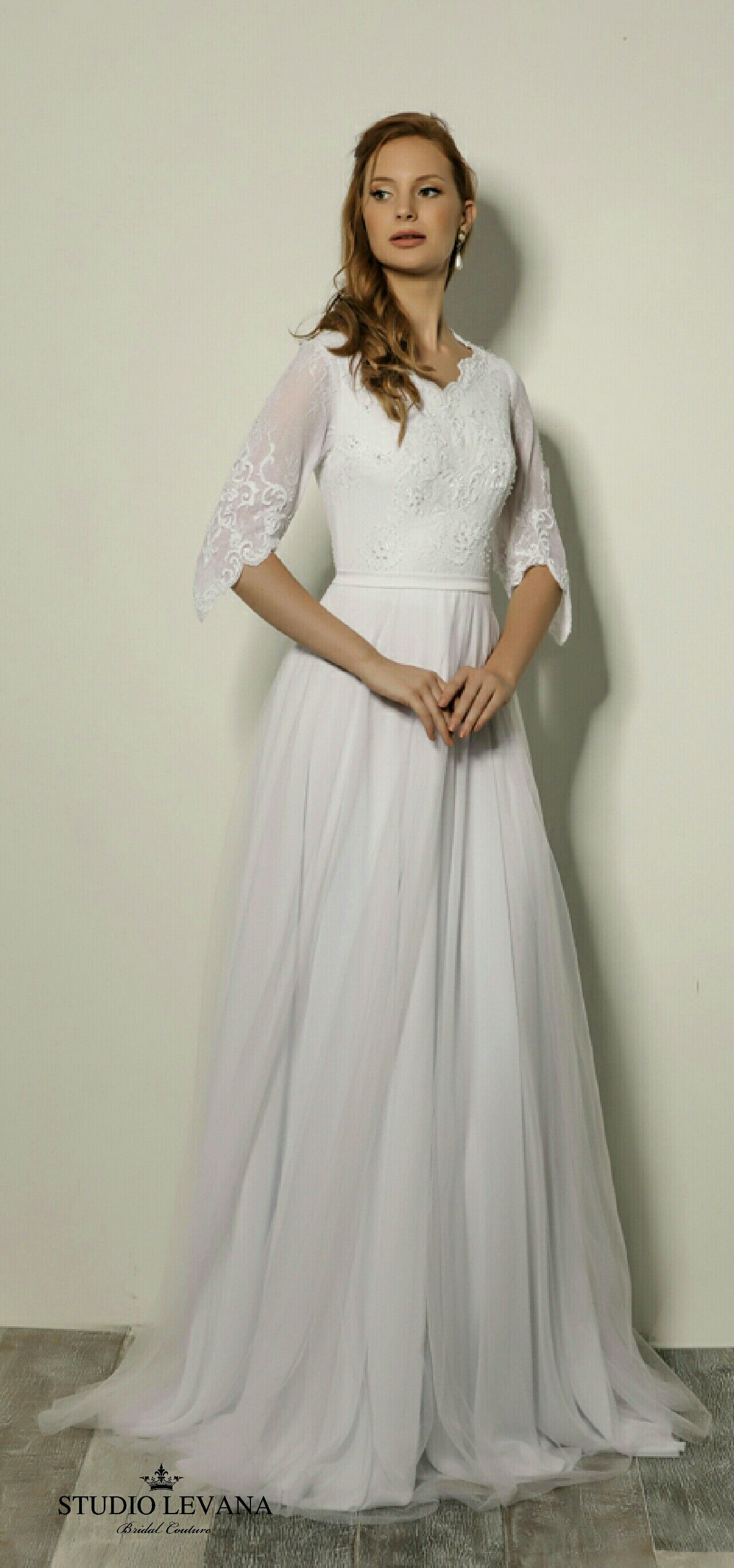 e540992689725 Modest wedding gown with beaded lace top and wide sleeves. Trish. Studio  Levana