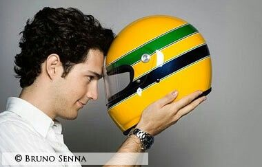 Bruno Senna holding his uncle's iconic yellow helmet.