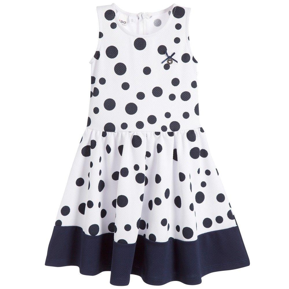 Girls white sleeveless polka dot dress by iDo Junior.