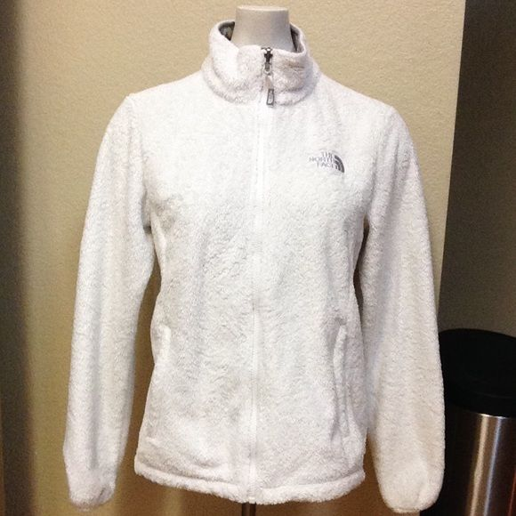 True North Face Osito White Gray Sz M Gently worn in good used condition! Size Medium in women's. White with a gray North Face on the left chest. There is one tiny stain not noticeable but I just had to point it out. I don't used bleach but that may be an option. It's extremely warm and still fuzzy. From a pet and smoke free home! The North Face Jackets & Coats