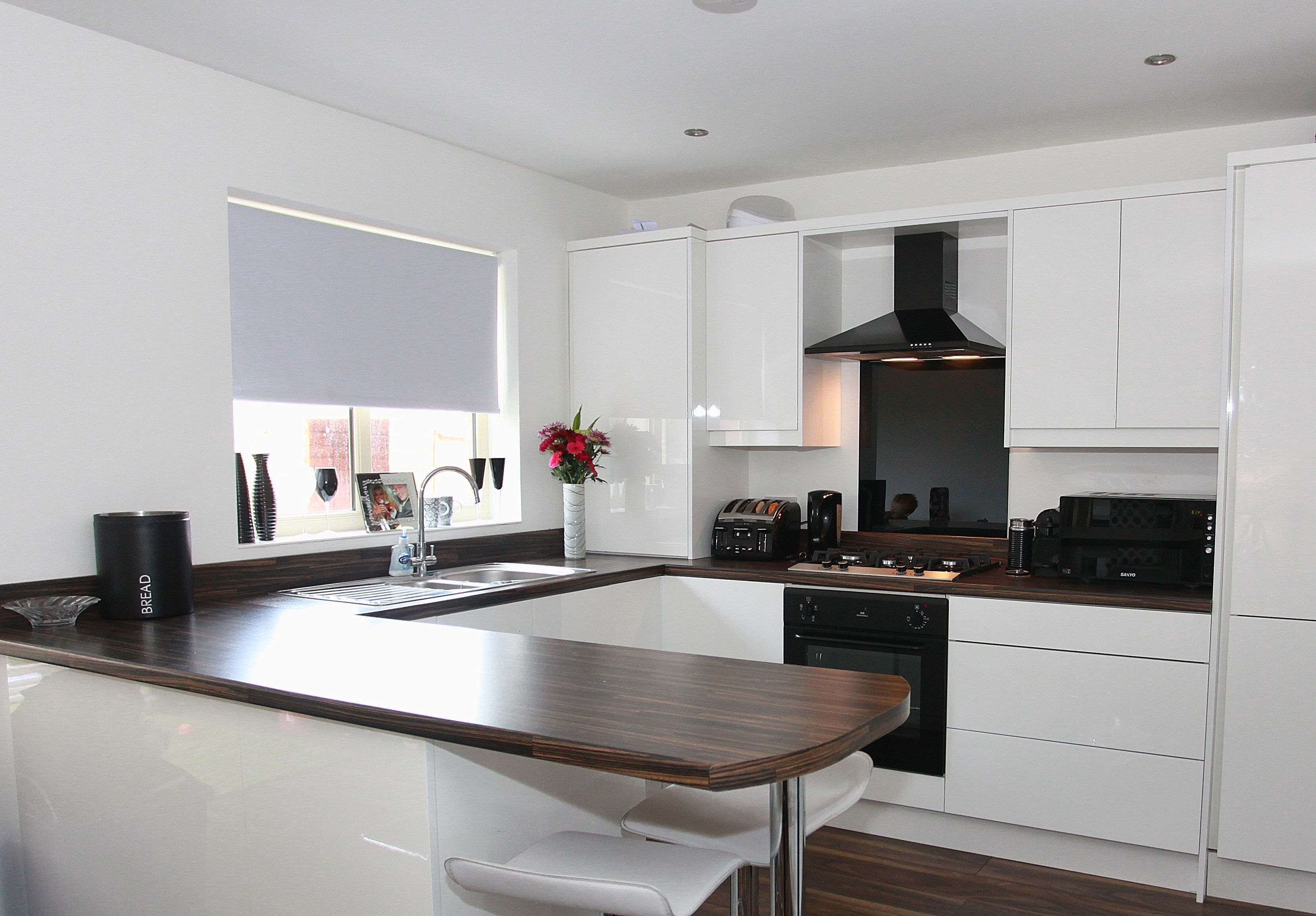 One of our beautiful Portland Hall Gloss White Kitchens