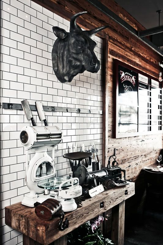 white subway tile mixed with rustic wood the wood is great the tile is great and that bovine head is awesome ideas for a steak restaurant