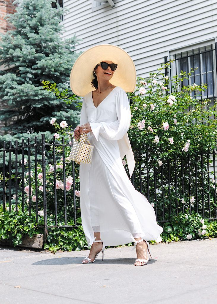 A long white dress with elegant accessories makes for the perfect summer look. Check out the style and more at Scout the City! #fashion #summer #whitedress