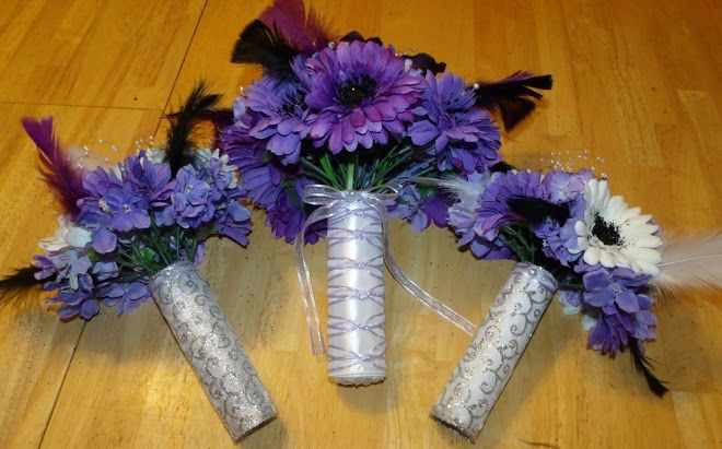 Silver handles on bouquets at www.silkweddingflowersforless.com