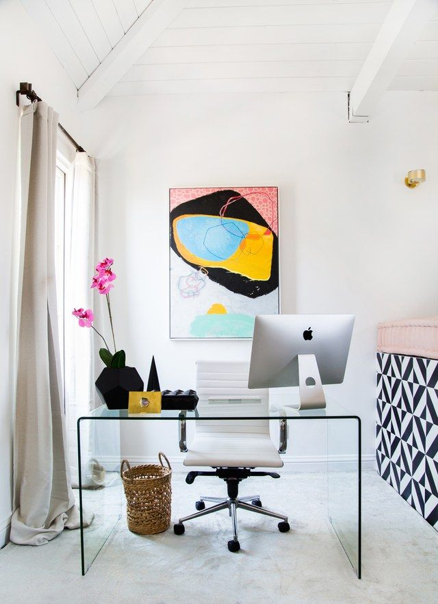 Art by Elisa Gomez adds a bright pop over this clear desk | archdigest.com