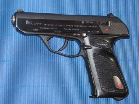 HK P9S pistol. Note the heel magazine release and a cocking/decoking lever behind the triggerguard.