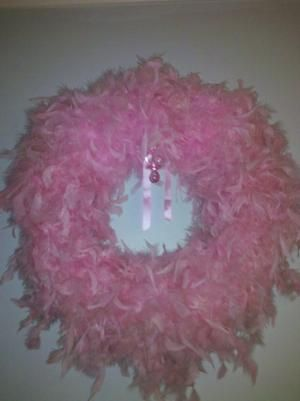 Feather boa wreath .. would be cute for girls bedroom. by leta