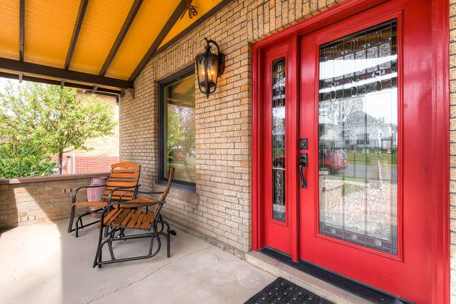 Craftsman Front Door And Porchlight On A Lovely Brick Bungalow.
