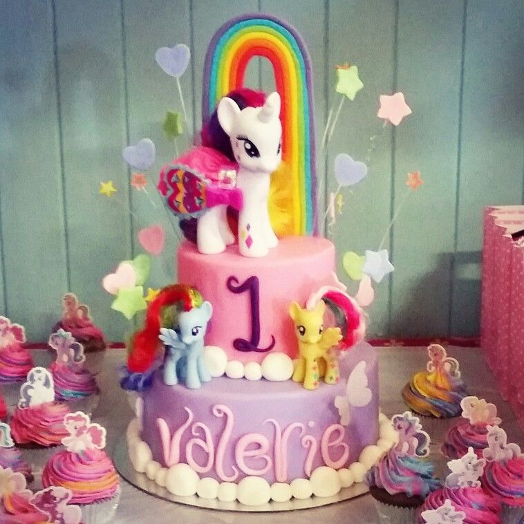 A Two Tier Pink And Purple Girly First Birthday Cake Themed To My Little Pony Featuring My Little My Little Pony Birthday Party Pony Birthday Party Pony Cake