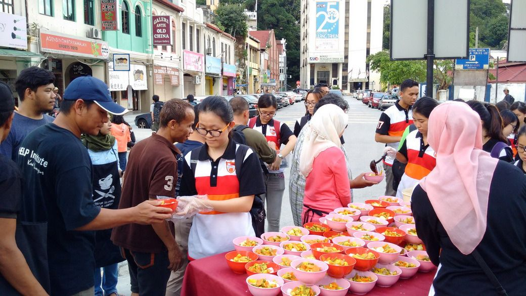 Volunteers From Dapur Jalanan Providing Food To The Homeless In Kuala Lumpur