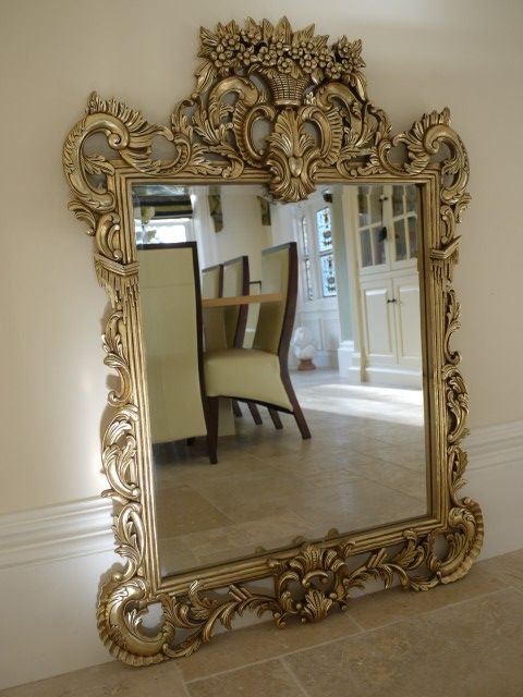 Decorative Gold Mirrors. This large decorative hand carved wooden ornate antique gold mirror has a  stunning floral crested top
