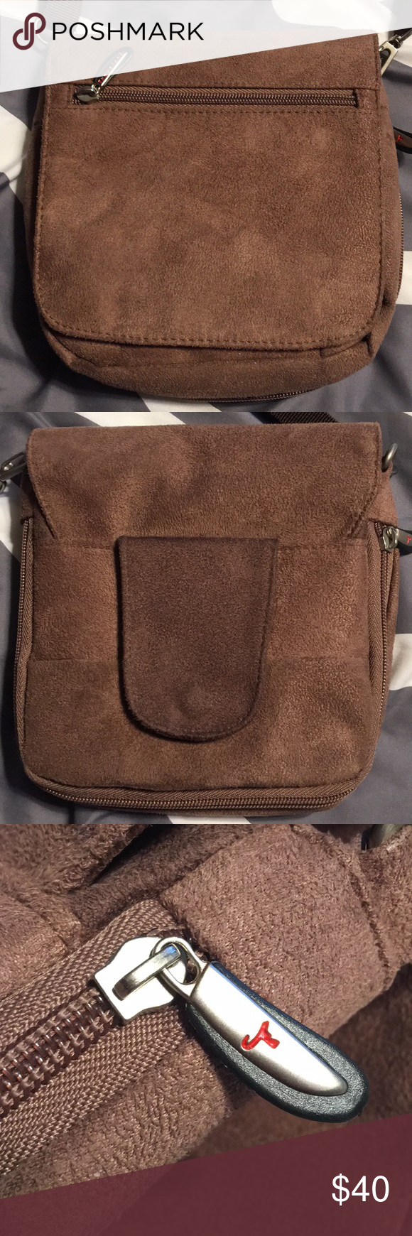 Adjustable 26 inch drop strap. Multiple compartments. See pics for details.  Bag measures 7x7 approx with expandable zipper. Travelon Bags Crossbody Bags 18066224ec