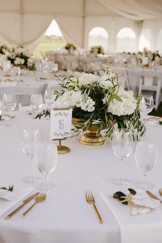 Classic, clean, white, modern table setting in a big white tent ...
