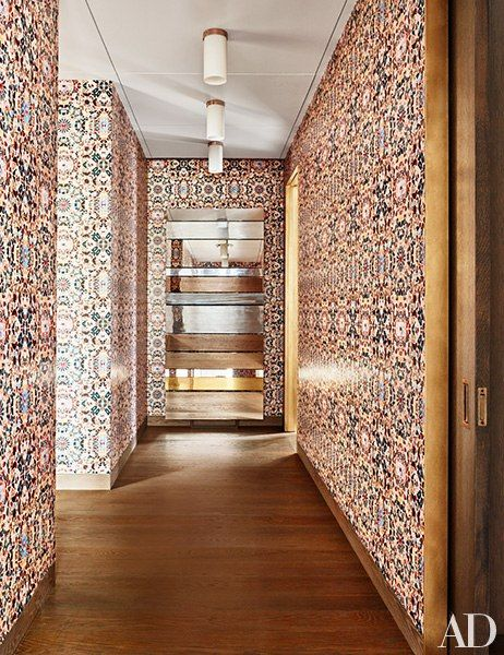 A limited-edition Damien Hirst wallpaper lines the master suite's hallw