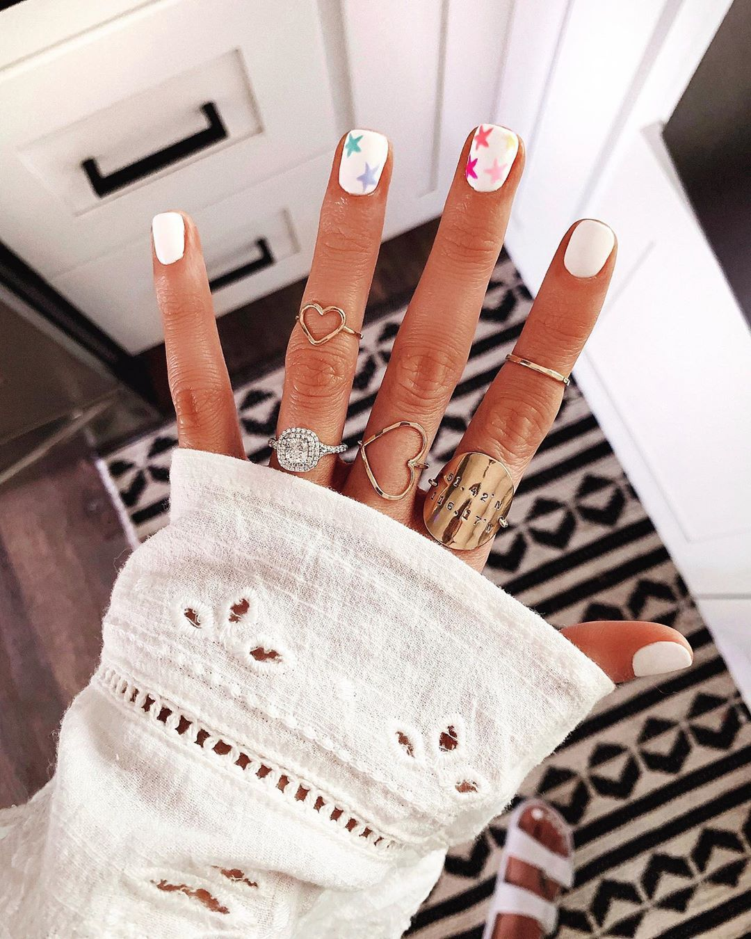 Weekend Ready Went With A Classic White Manicure With Rainbow Stars How Cute Are These By Stell Star Nails Star Nail Designs Summer Acrylic Nails
