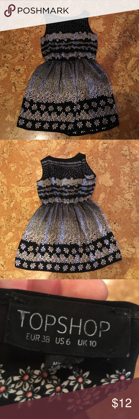 Daisy Topshop Dress Size 6 US dress from Topshop. Super cute daisy pattern and a cut that's flattering on any body type. In great shape and worn rarely. Cannot recommend this dress more for brightening your day! 🌸🌸🌸 Topshop Dresses