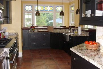 Example Of Black Cabinets With Saltillo Tile Design Ideas