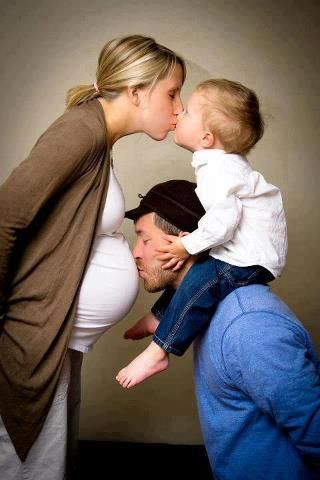 Family Pose Mom Kissing Son Dad Belly