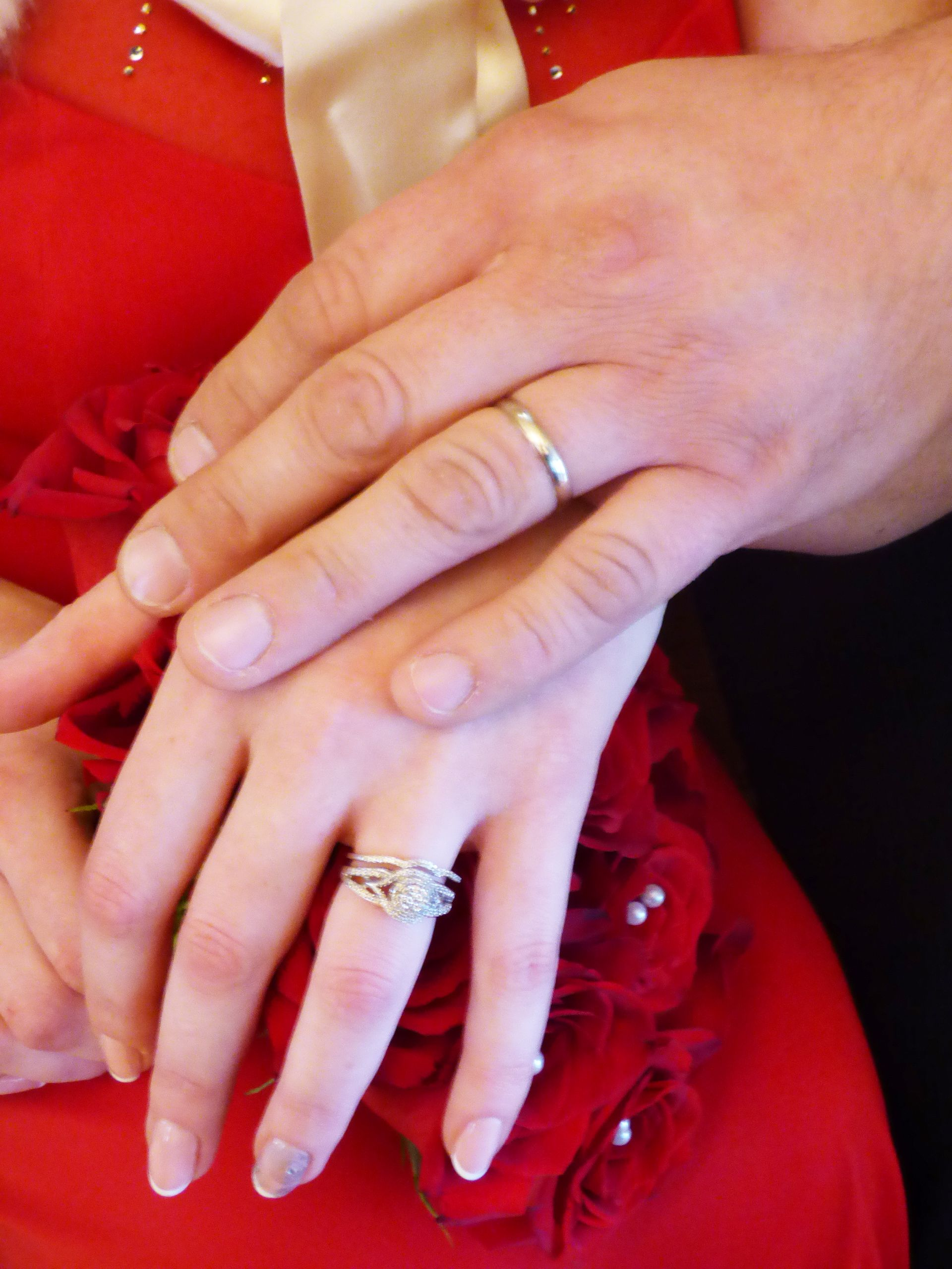 red wedding dres and red roses wedding ring hand shot by Rev Pam at ...