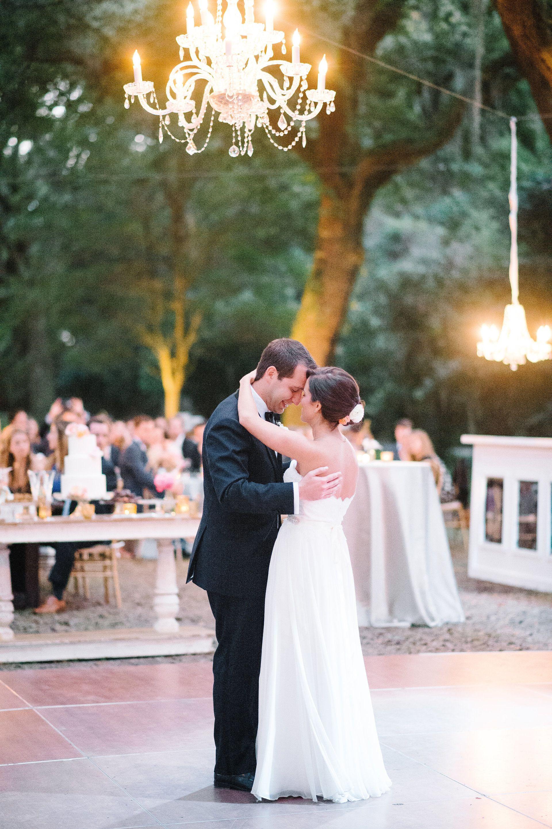 Romantic wedding reception lighting, crystal chandeliers, outdoor dance floor // Aaron and Jillian Photography