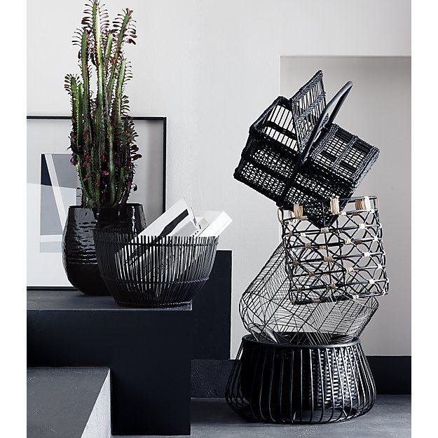 Shop beso baskets.  Two-tone rattan twists an open weave catchall around a sturdy iron frame. A beautiful contrast in neutrals.#cb2contest