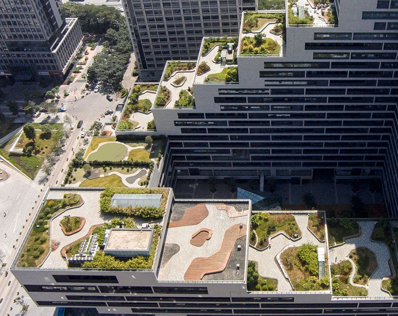 This Building Is Covered In Fully Landscaped Rooftop Terraces Roof Landscape Rooftop Design Terrace Building