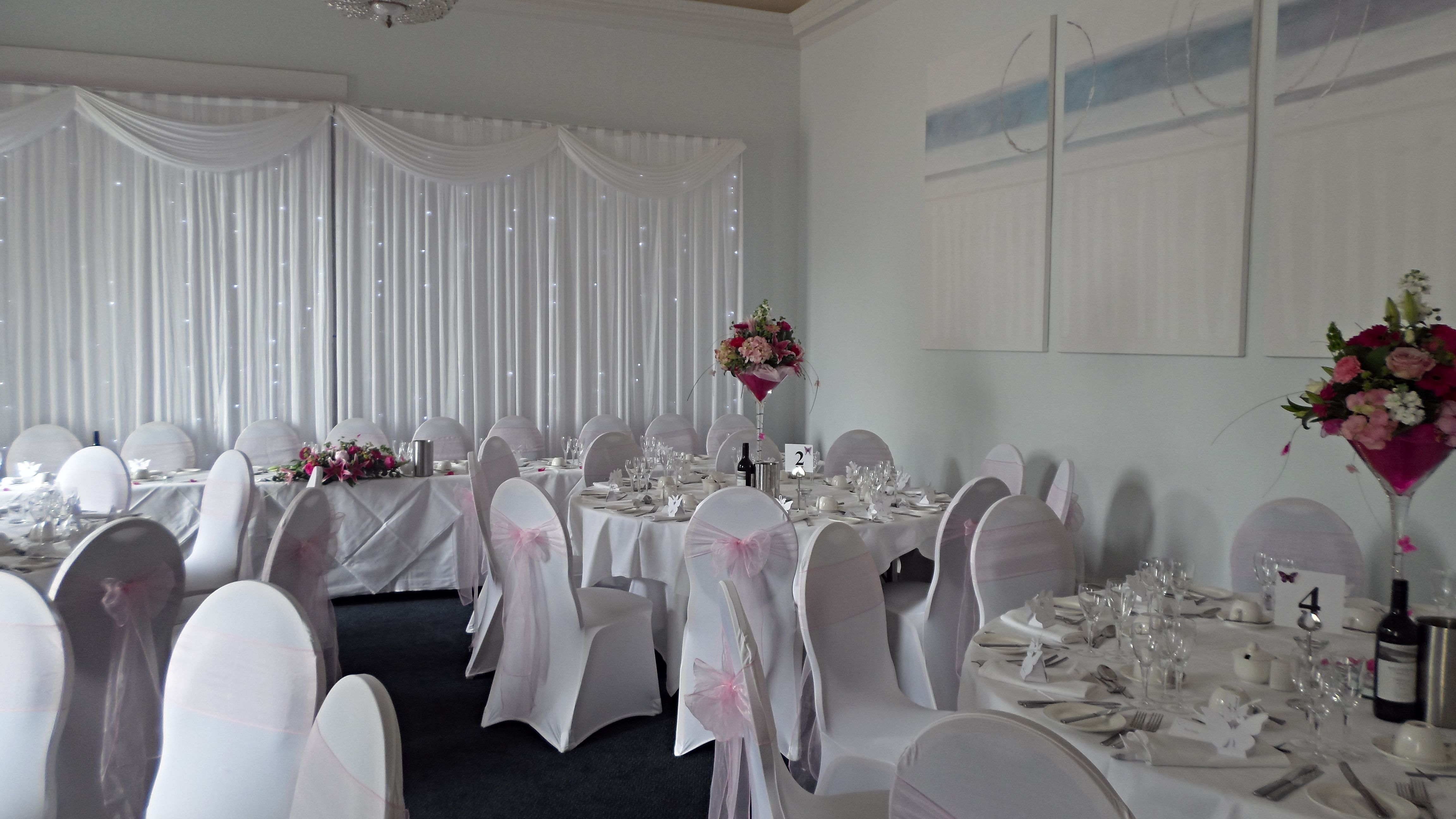 Starlight Wedding Backdrop With Spandex Wedding Chair Covers And Baby Pink Sashes By Jda Hire Www Jdahire Co Uk Wedding Chairs Wedding Set Up Wedding Sets