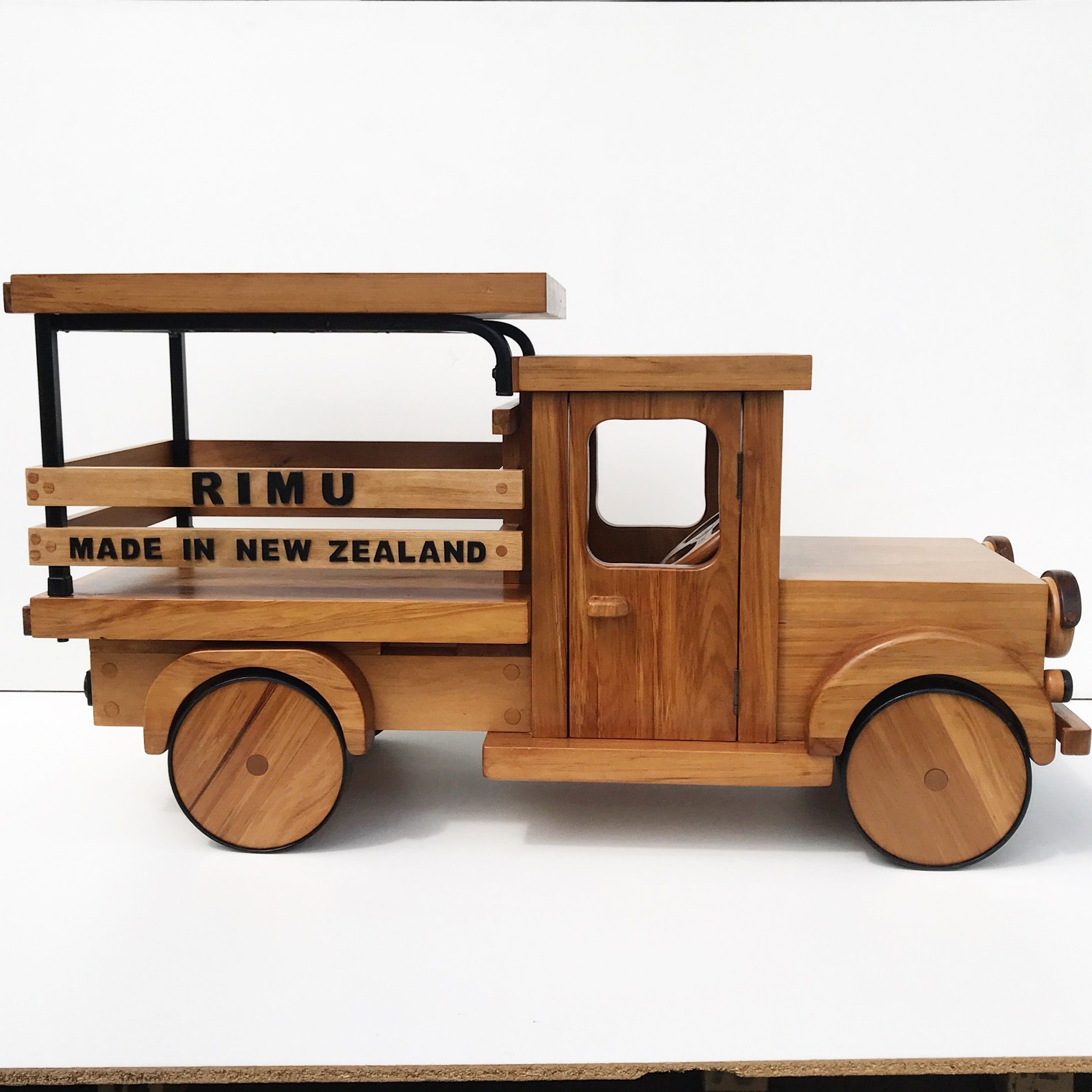 handcrafted car. made of nz rimu wooden craft shop | new