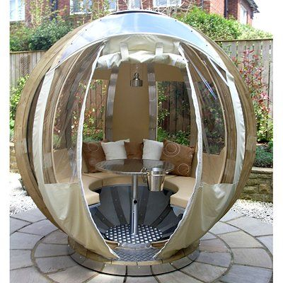 bizarre but strangely fun, rotating sphere lounge for the garden, fantastic if you want some space but don't have room for a conservatory....