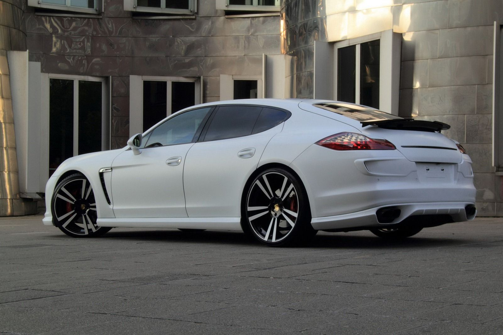 porsche panamera gts with a set of wheels with white carbon fiber barrel and white and blue colored aluminum center - Porsche Panamera Turbo 2014 White