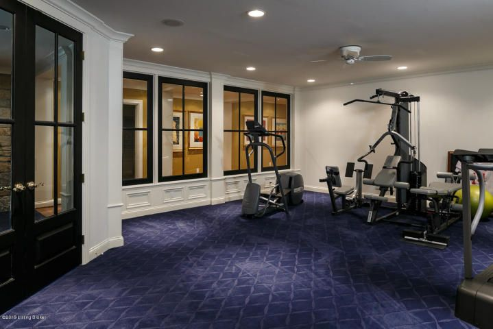 Papa John's house:Huge modern workout room with windows that look out to the family living space.