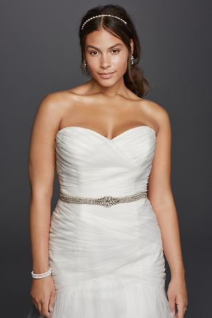 """From the sweetheart neckline to the ethereal tulle skirt, this strapless mermaid wedding dress is a study in loveliness. Ruching from the bodice through the hips and a lace-up back create a figure-flattering effect.  David's Bridal Collection - Plus Size Extra Length.  4"""" extra length dress.  Also available in Regular, Petite, Plus Sizeand Extra Length. Check your local stores for availability.  Sweep train. Fully lined. Imported. Back lace up. Dry clean only. Cherish your"""