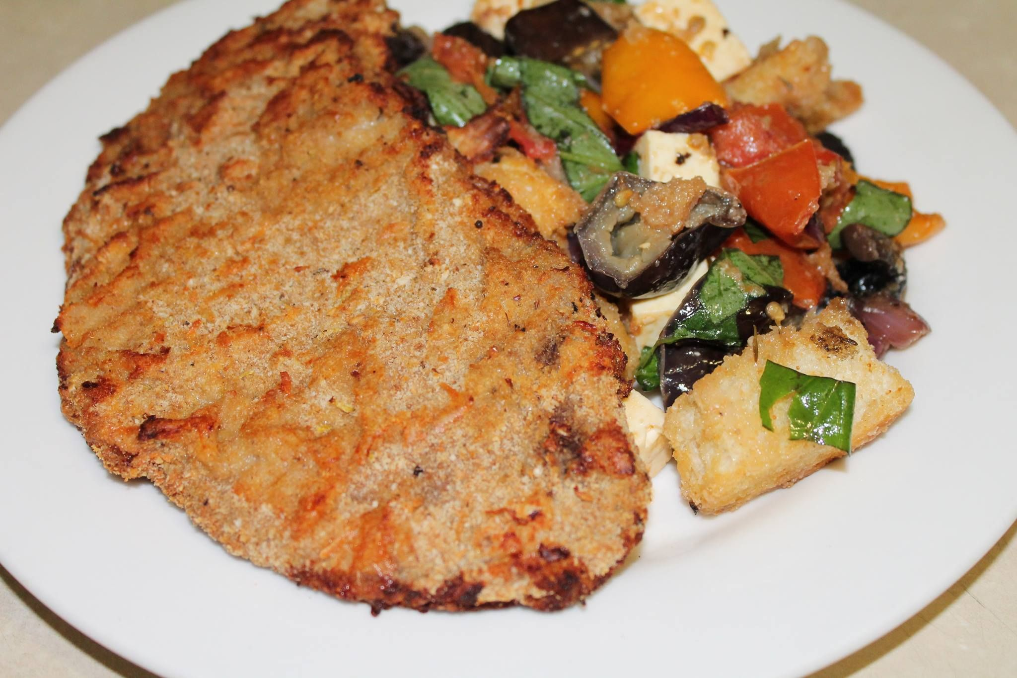Parmesan and thyme crumbed veal chops with my version of Panzanella-