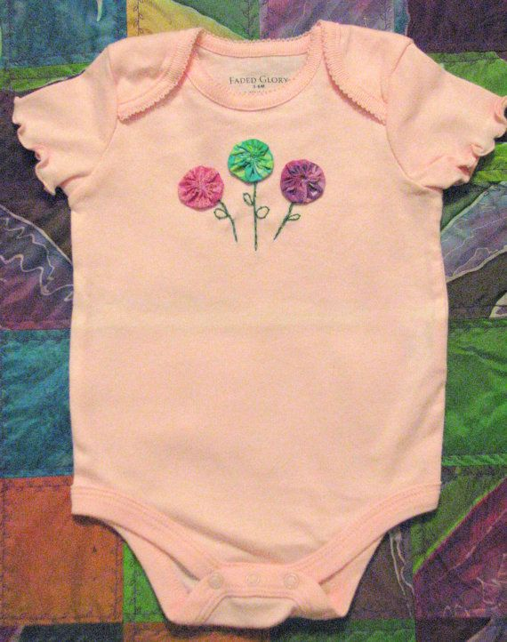 Hand embroidered yo yo flowers on pink little by Onceuponaonesie, $15.00