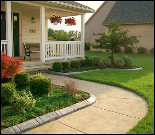 Stamped concrete landscape edging custom decorative for Plants for landscaping around house