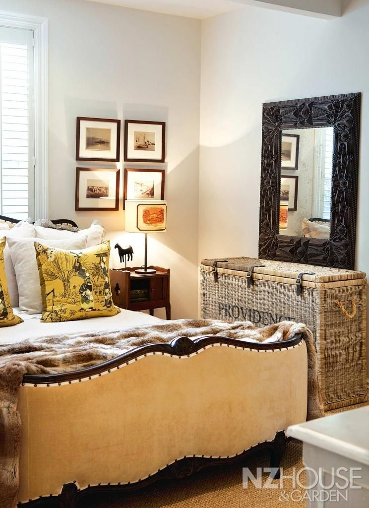 Mary had this French bed in one of the guest rooms reupholstered with velvet and studs; the mirror is Ralph Lauren and the basket from Le Mo...