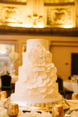 All White Wedding Cake On Flat Silver Stand