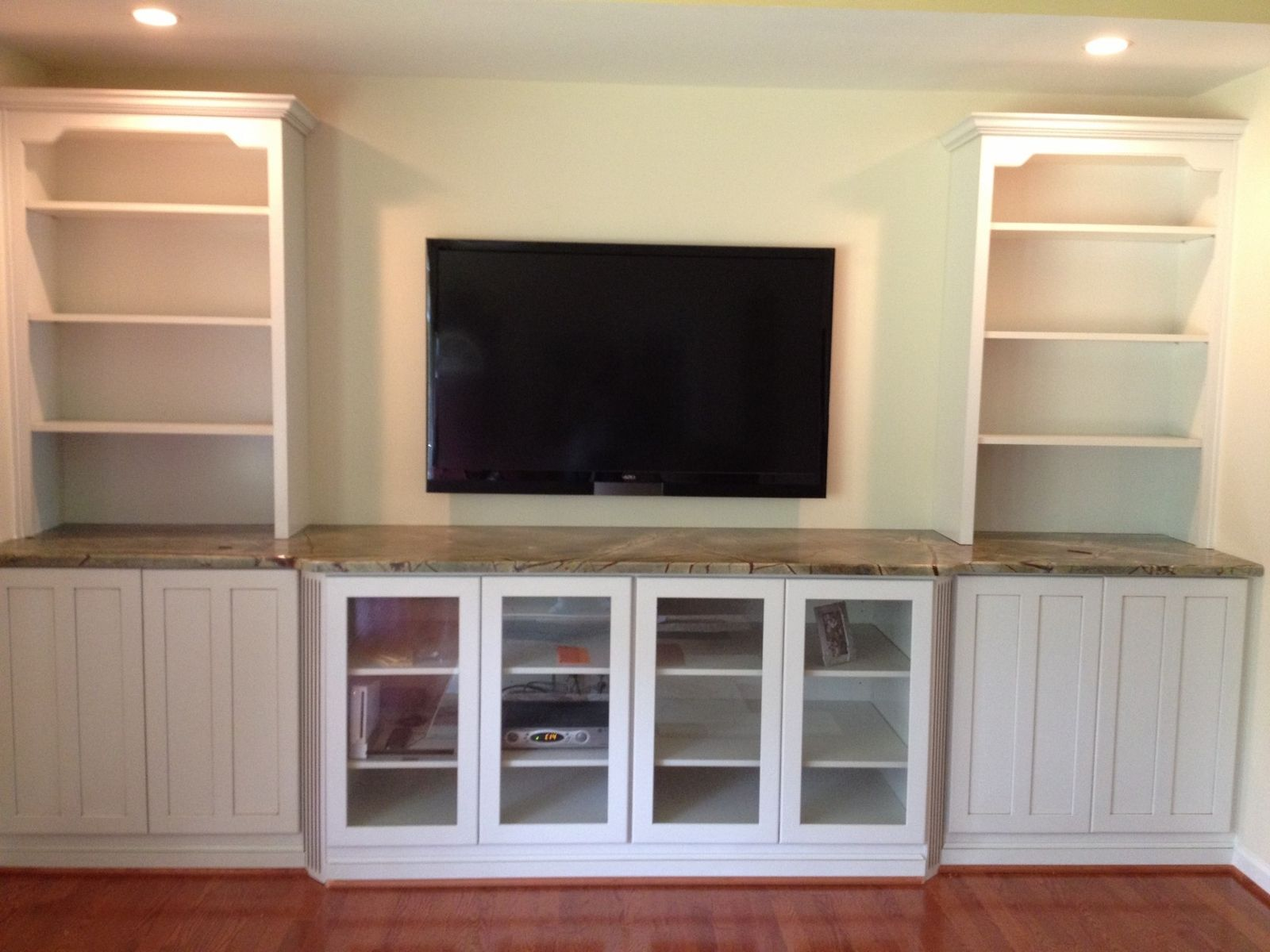 Dining room built in wall unit hand crafted built in tv for Built in wall units