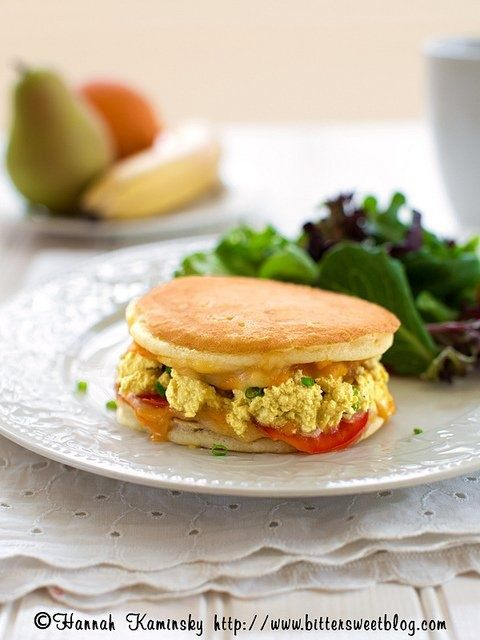 Holy Breakfast Sandwich! Hannah Kaminsky's creation consists of two fluffy pancakes, Mexican-style vegan cheese shreds, rich tofu scramble and fresh tomato.