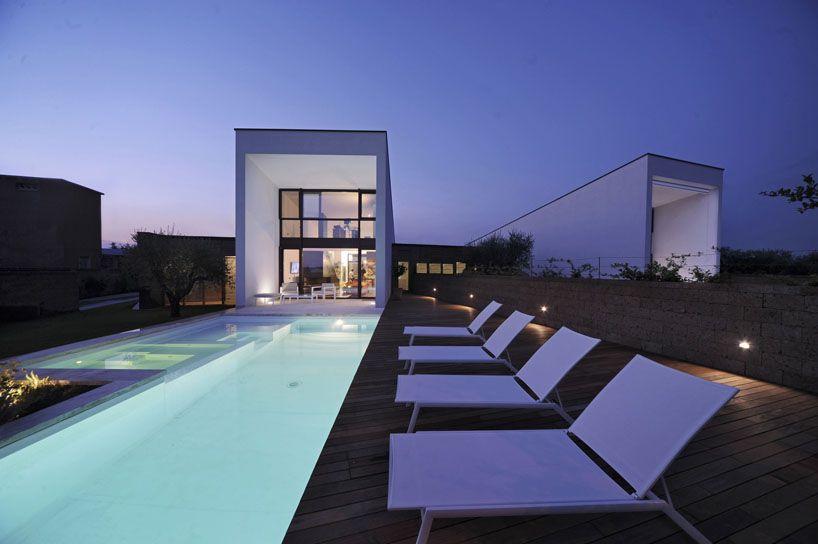 romano adolini's double house features two rectilinear volumes  piscina junto com jacuzzi e prainha !