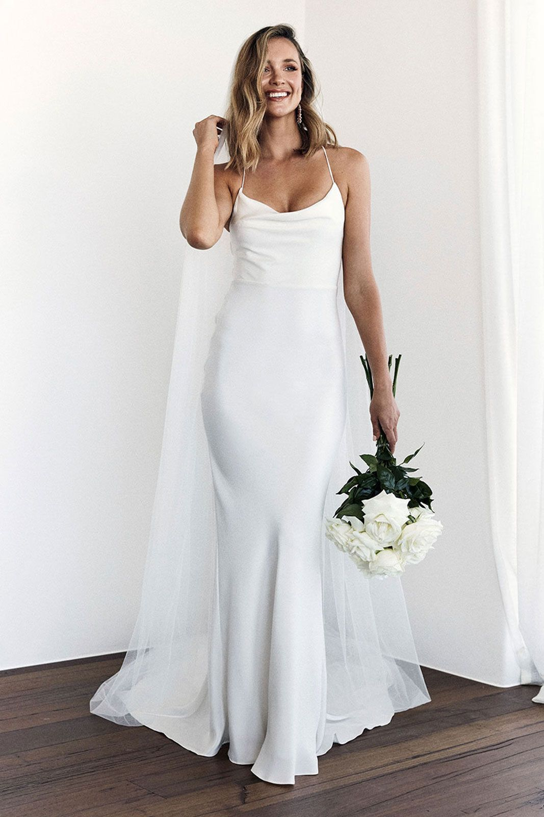 A Luxurious Double Layered Crepe De Chine Silk Wedding Gown With