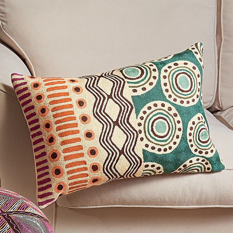 embroidered cushion with soothing colours that go well on a neutral background