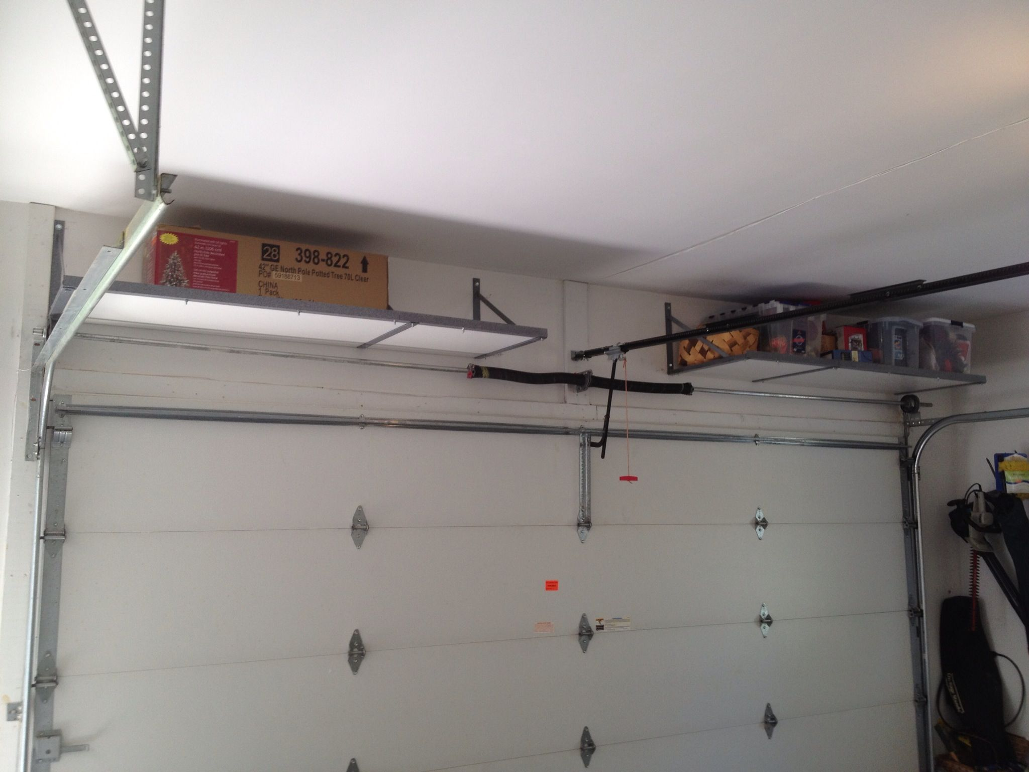 Over Garage Door Shelf Overhead Storage Knoxville Over Garage Racks Garage Ceiling Storage Overhead Garage Storage Diy Garage Storage