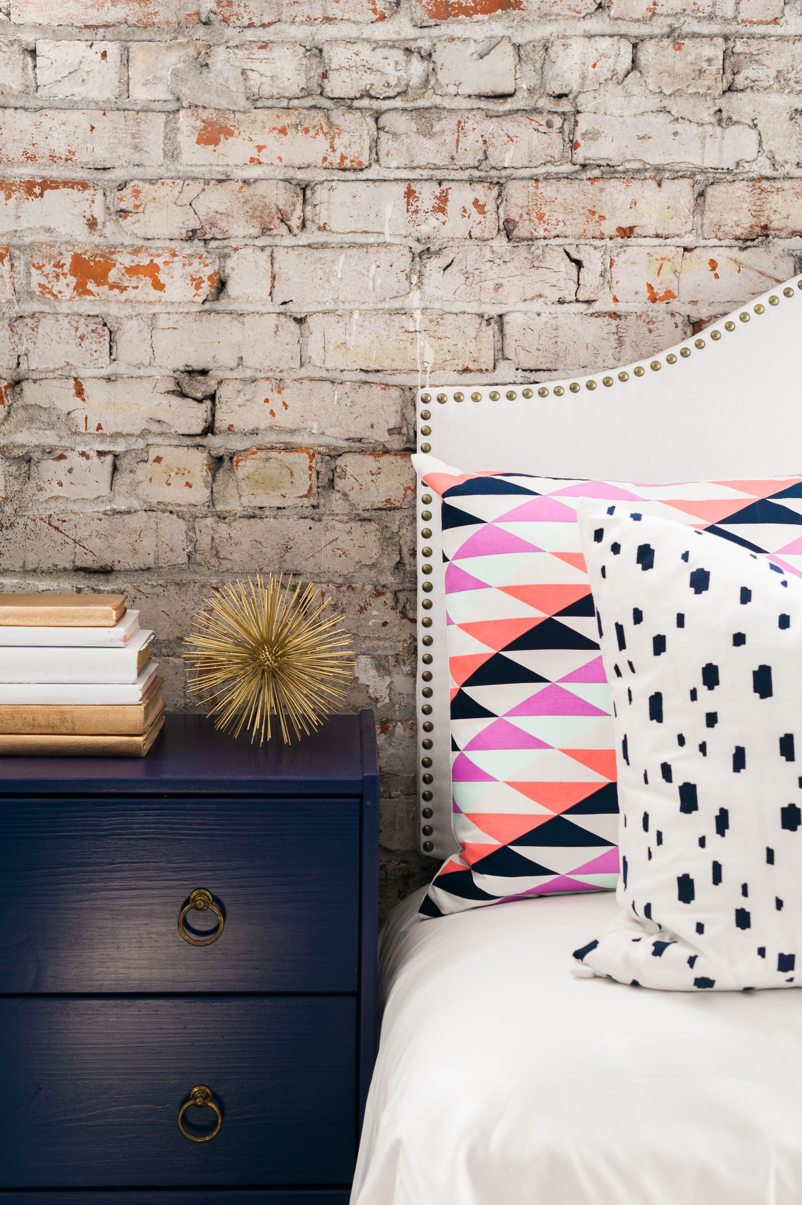 Navy spotted pillow bricks walls and exposed brick