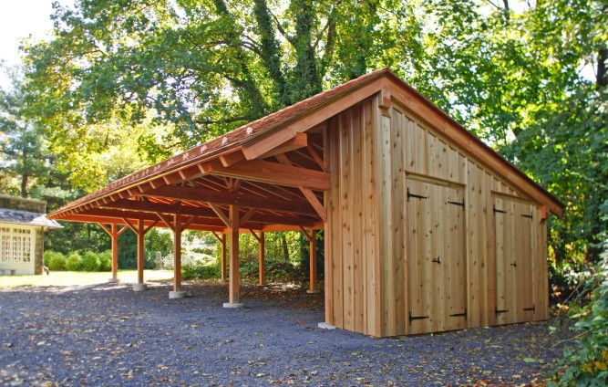 The timber frame carport even includes a potting shed with two doors