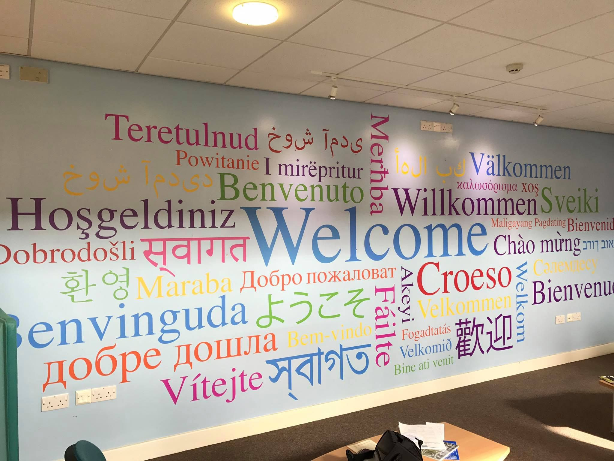 Huge Word Cluster Wall Graphic Designed And Installed By Wallboss Each Word Says Welcome In A Differe School Interior School Hallway Decorations Wall Design