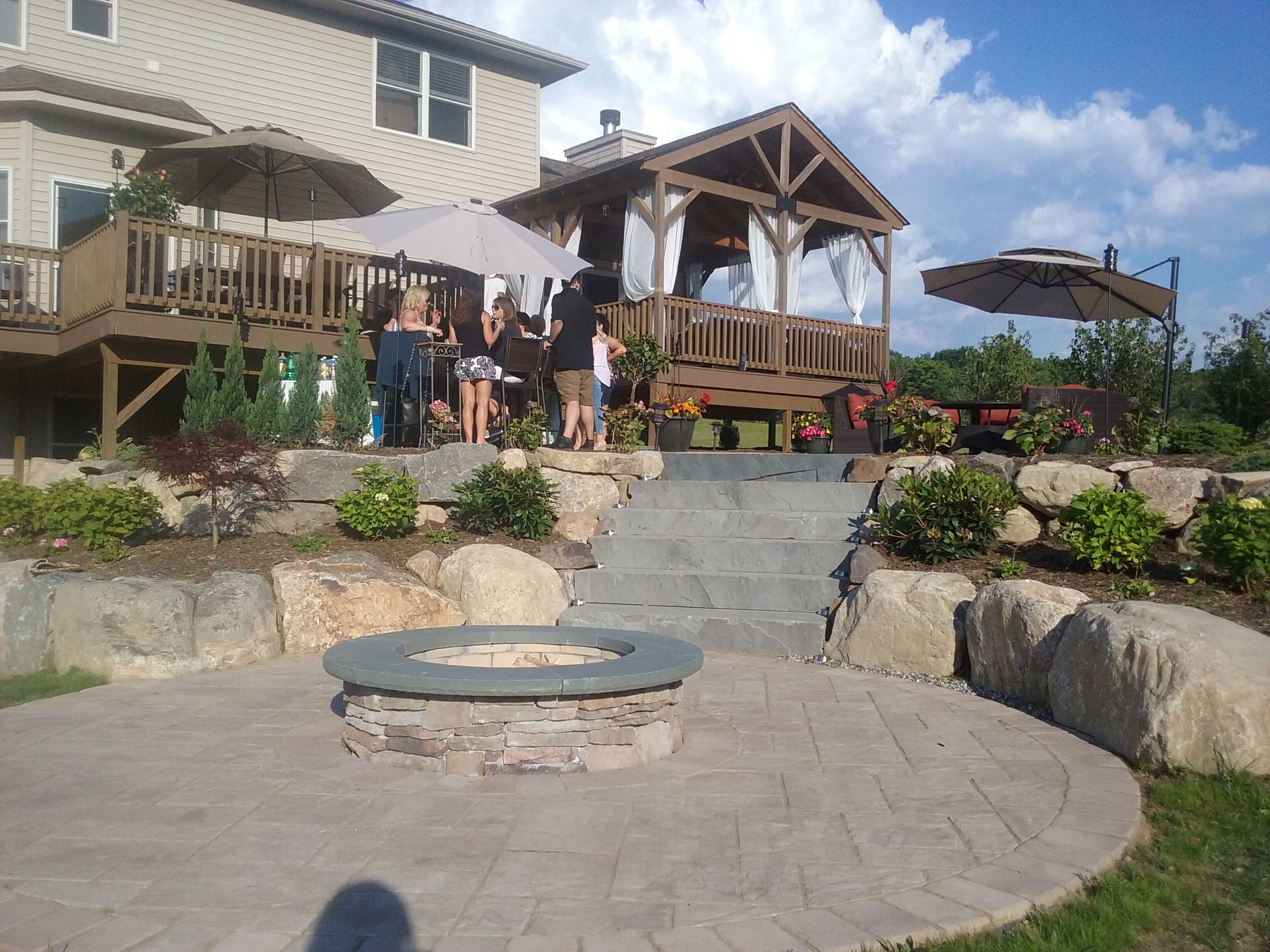 Perfect patio with firepit great for entertaining! Natural ... on Rock And Stone Outdoor Living id=75021