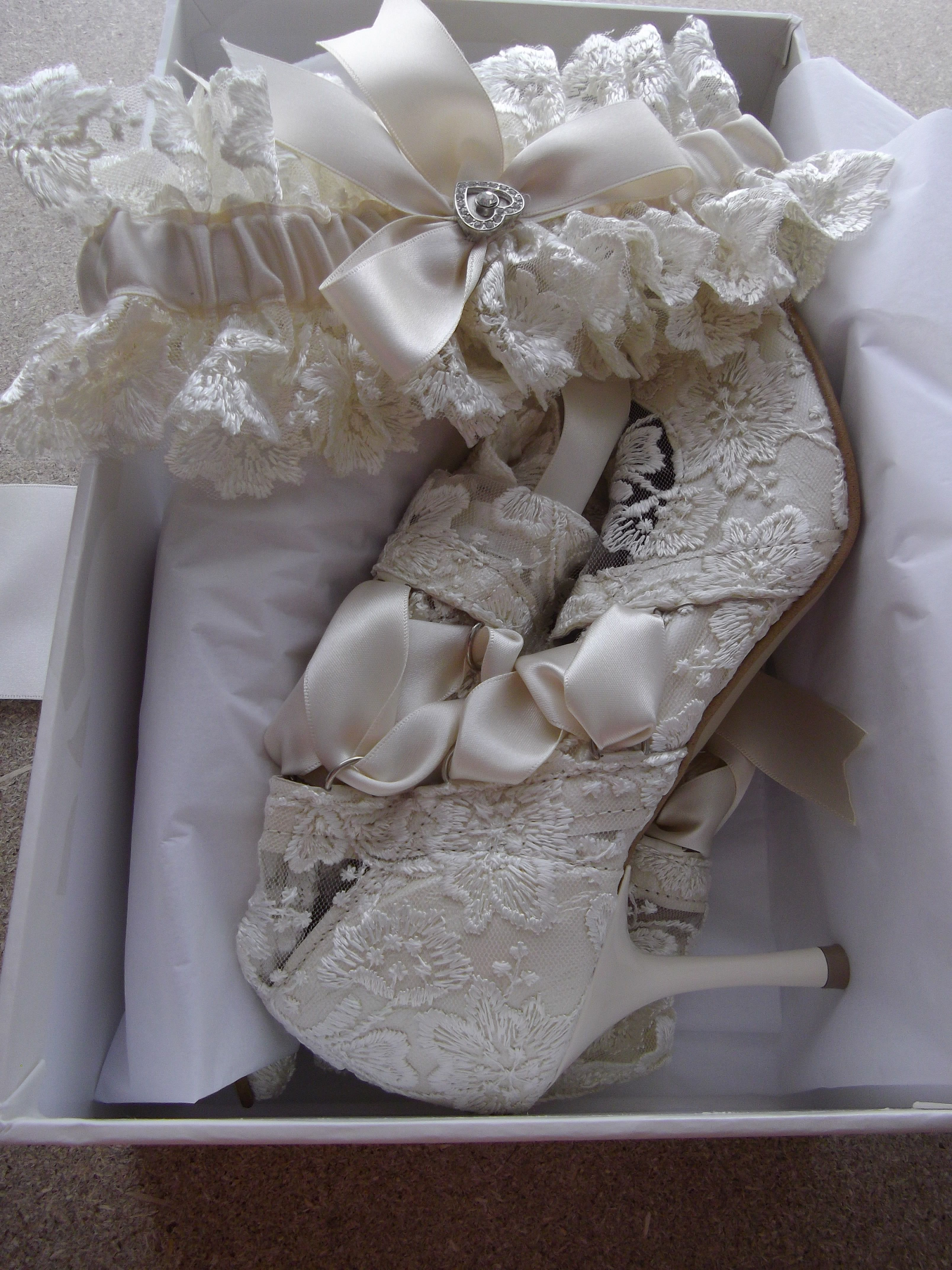Wouldn't you love to receive these gorgeous lace wedding boots with matching garter
